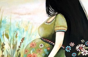 mujer-feliz-con-su-embarazo-305x200